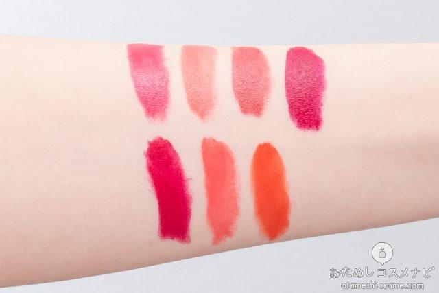 7色の口紅を塗った女性の腕